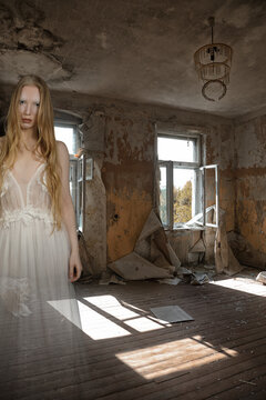 Ghost of a girl in a room of an old abandoned house