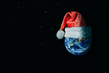 Wall Mural - The whole earth for christmas is wearing a santa hat on the cosmos backgrounds. Elements of this image furnished by NASA