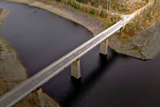Bridge over the side basin of a dam in a German mountain range, aerial view
