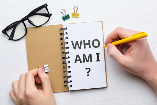 Handwritten question who am i concept on paper