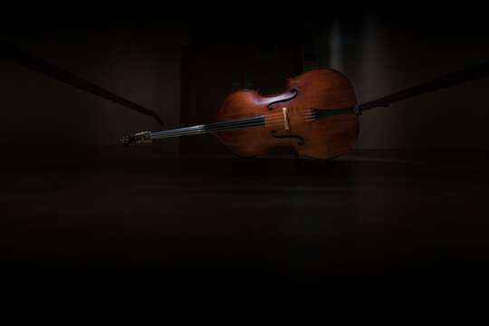 A double bass in a dark hall