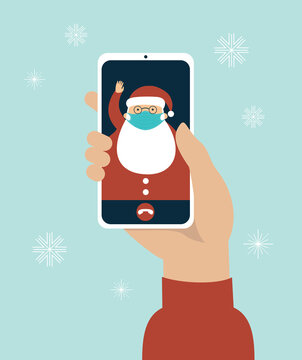 video call on the screen with Santa Claus wearing a protective medical mask. COVID-19 2019-ncov disease pandemic. Safety measures.