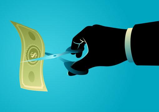 Businessman hand with scissors cutting money bill