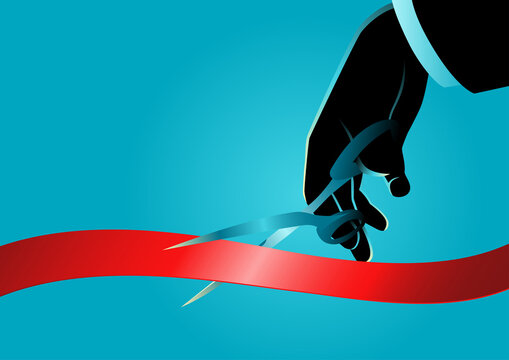 Businessman hand with scissors cutting red ribbon