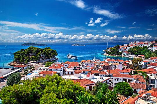 View of the old port of Skiathos town from the clock tower of Agios Nikolaos church. Skiathos island, Northern Sporades, Greece.