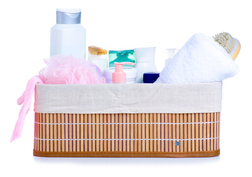 Basket with bath cosmetics, towel on white background isolation