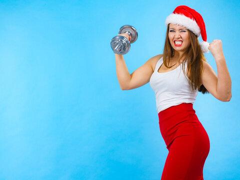 Santa claus woman lifting dumbbells