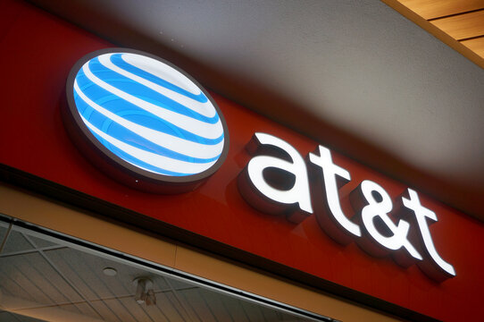 at&t Logo sign on wall above store in Ala Moana Mall