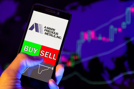 Company logo ABERCROMBIE & FITCH CO. on smartphone screen, hand of trader holding mobile phone showing BUY or SELL on background of stock chart. Russia, Stavropol, - May 25, 2019