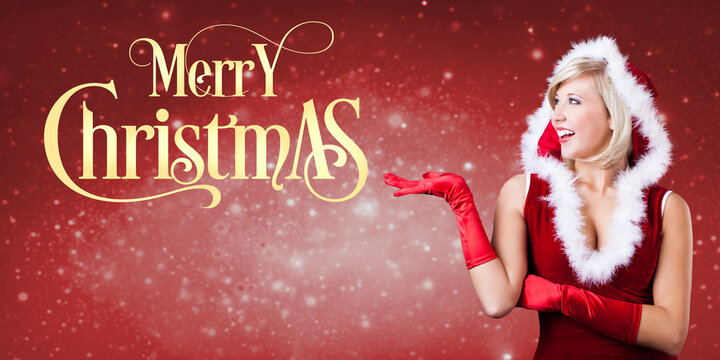 woman dressed as Miss Santa with message MERRY CHRISTMAS in front of christmas background