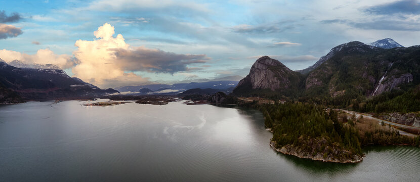 Aerial Panoramic view of Sea to Sky Highway with Chief Mountain in the background. Colorful Sunset Sky Art Render. Taken near Squamish, North of Vancouver, British Columbia, Canada.