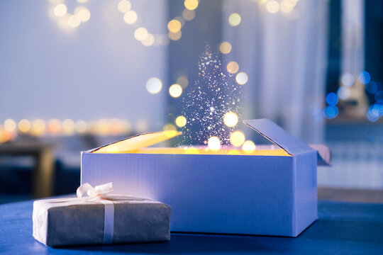 Magic background with gifts, dust and light for Christmas