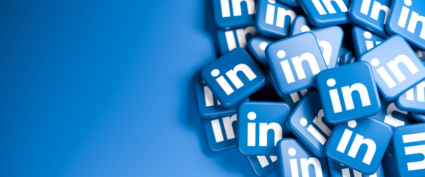 Logos of the business social media site and app LinkedIn on a heap. Web banner size with copy space - Selective focus