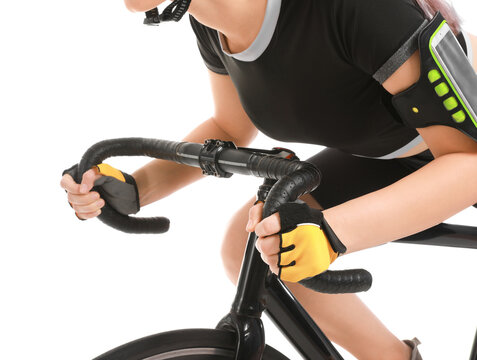 Female cyclist riding bicycle on white background