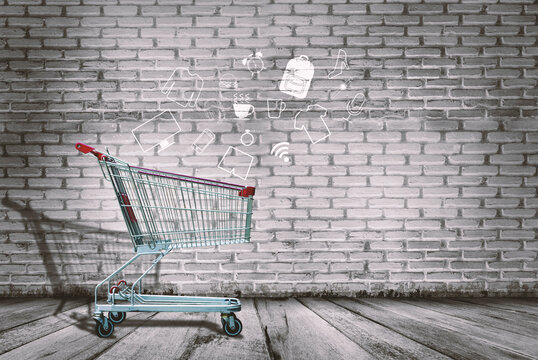 Digital Composite Image Of Shopping Cart With Icons Against Brick Wall