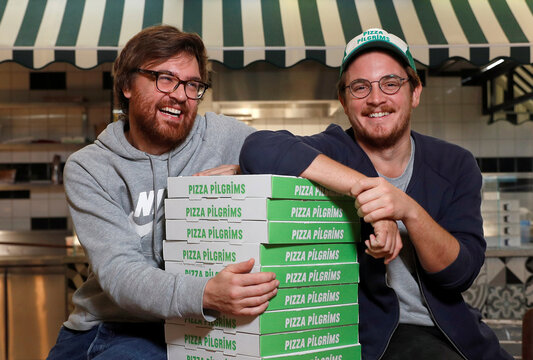 Co-founders of Pizza Pilgrims, brothers Thom (L) and James Elliot, pose for a photograph in one of their restaurants amid the coronavirus disease (COVID-19) outbreak in London
