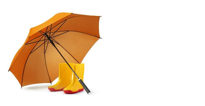 orange umbrella and gumboots