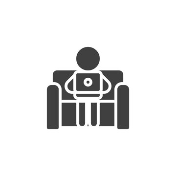 Working from home vector icon. filled flat sign for mobile concept and web design. Man sitting with laptop on the sofa glyph icon. Symbol, logo illustration. Vector graphics