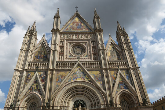 cathedral of Orvieto in Italy against a cloudy sky