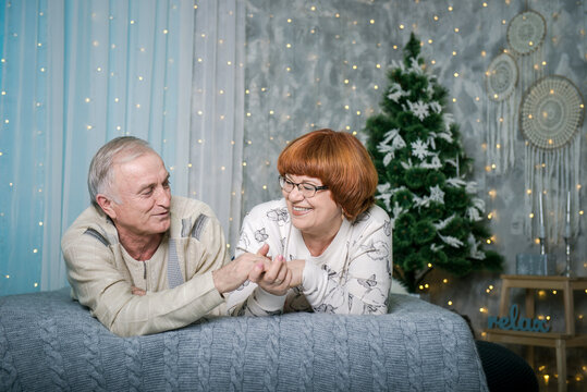 Man and woman in Christmas. Happy man and woman on the bed at home in Christmas.