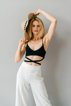 Beautiful young stylish blonde model posing in studio
