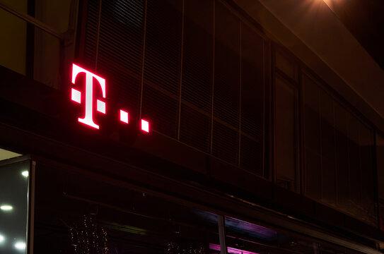 Telekom logo lights up at night in downtown Wolfsburg, Germany, November 21, 2020