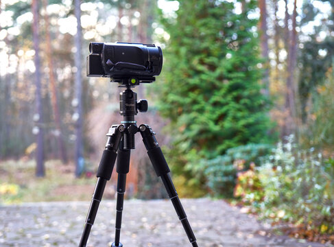 Rollei mini tripod with extended tripod legs and a camcorder in Gifhorn, Germany, November 23, 2020