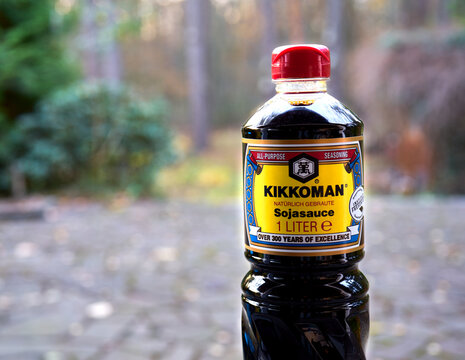Kikkoman soy sauce in a large bottle against a deliberately blurred background with bokeh, c in Geifhorn, Germany, November 23, 2020