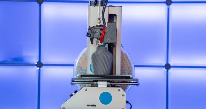 3D printer at work with printer 3D model