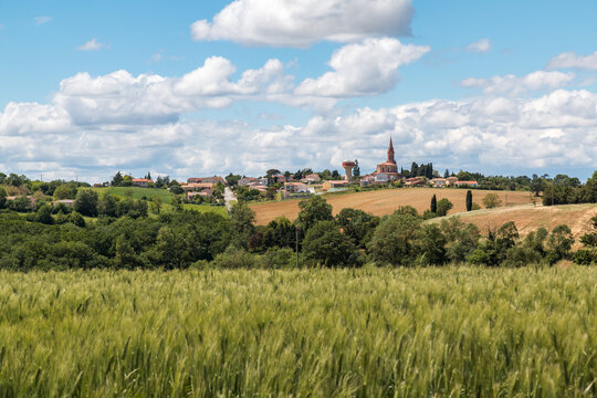 Country landscape in France, village on top of a hill