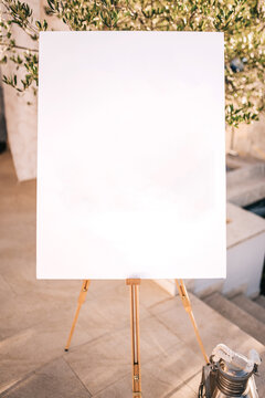 Wooden easel with white paper