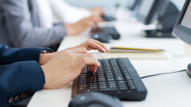 Closeup business people hands typing on keyboard computer desktop for using internet, searching data, working, writing email.
