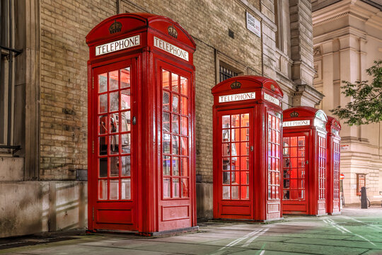 Famous red telephone booths in the evening, Covent Garden street, London, England