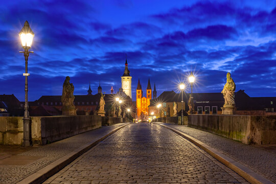 Old Main Bridge, Alte Mainbrucke with statues of saints, Cathedral and City Hall in Old Town of Wurzburg at night, Franconia, Bavaria, Germany