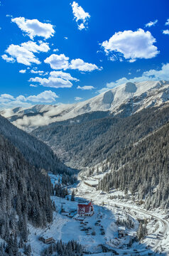 Capra chalet in Fagaras mountains in winter. The ridge of the mountain full of snow. There are one of the beautiful road in the world, Transfagarasan, chalet