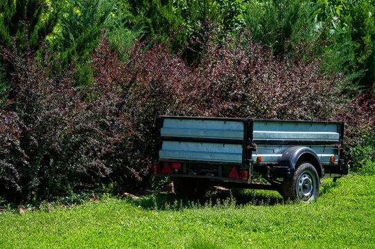 Close up of little trailer in summer garden