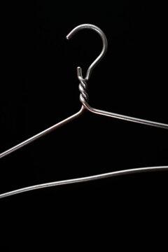 simple metal hanger on a black