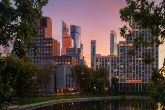 Moscow city in Russia at dramatic sunset. Park Krasnogvardeyskiye Prudy (pond Krasnogvardeyskiy)