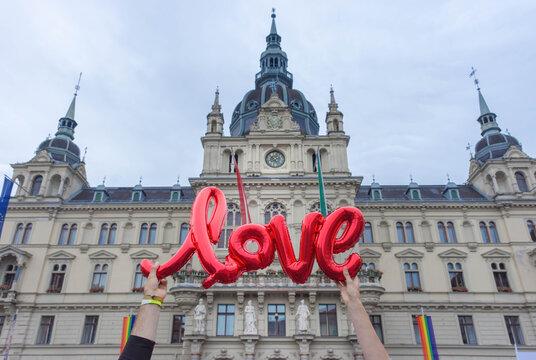 Love sign and beautiful town hall building Rathaus at main square Hauptplatz in Graz, Styria region, Austria