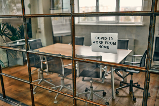 Empty office space while the officer works from home to avoid the corona virus. The worker follows social distancing and stays at home to prevent COVID-19 infection and reduce the pandemic.