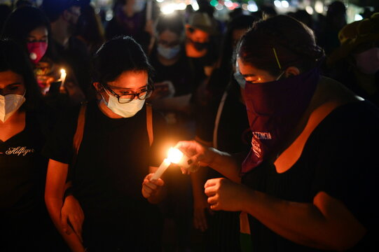 Women light up candles during a protest to mark the International Day for the Elimination of Violence against Women, in San Salvador