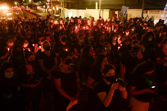 Women take part in a protest to mark the International Day for the Elimination of Violence against Women, in San Salvador