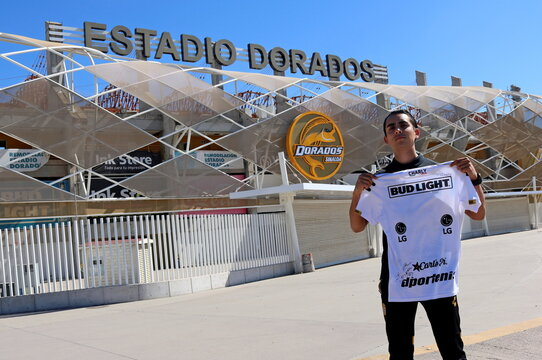 A fan shows a jersey of the Dorados de Culiacan team signed by late Argentine soccer Maradona outside the Dorados stadium in Culiacan