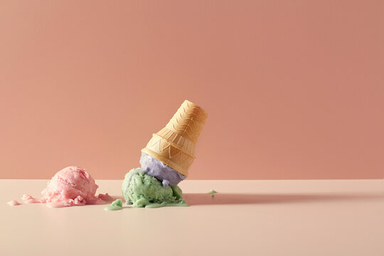 Ice Cream and Wafer Cup Cone melted on table