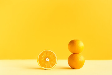 Citrus fruit orange on yellow background. Art trendy minimalist still life. Healthy lifestile....