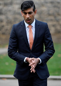 Britain's Chancellor of the Exchequer Rishi Sunak walks following an outside broadcast interview, in London