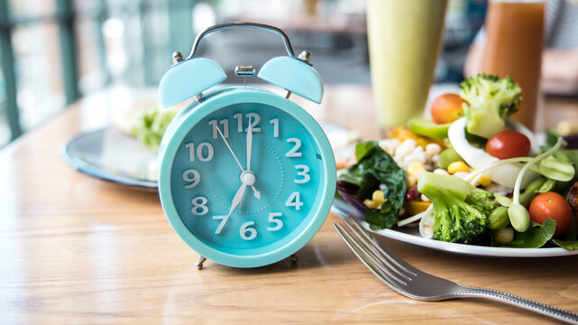 Time to lose weight and selective focus of blue clock and eating control or time to diet concept-Intermittent fasting