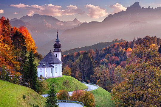 Bavarian Alps. Landscape image of the Bavarian Alps with Maria Gern Church and Watzmann mountain during beautiful autumn sunset.