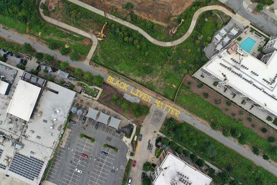 """Black Lives Matter"" Written on the Atlanta Beltline in Yellow Letters - Atlanta, GA, Aerial View"