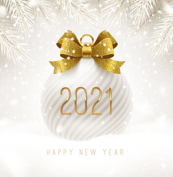 Holiday white bauble with glitter gold bow ribbon and New year 2021 number. Christmas ball on a snow. Vector illustration.